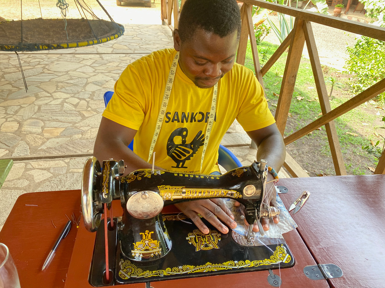 Gideon Dodea at work sowing plastic sachets