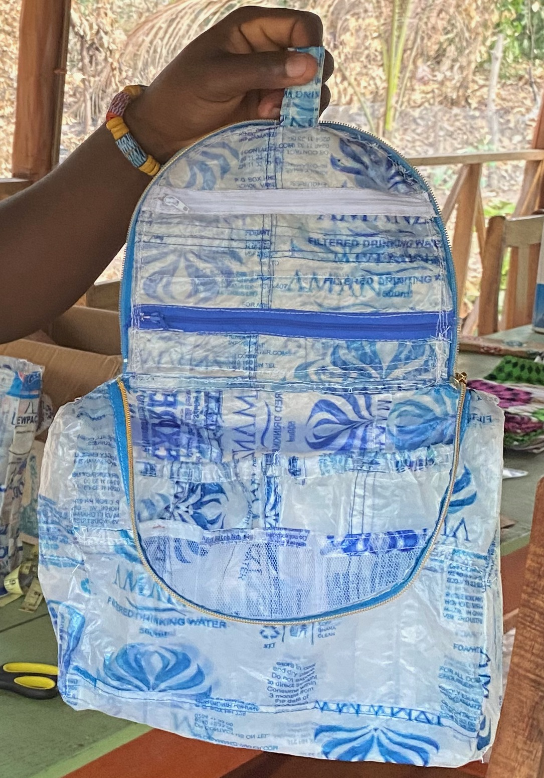 Toilettries bag made of water sachets.
