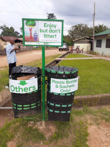 Plastic waste bins in the village